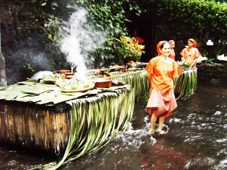 Native Cooks Serving Food