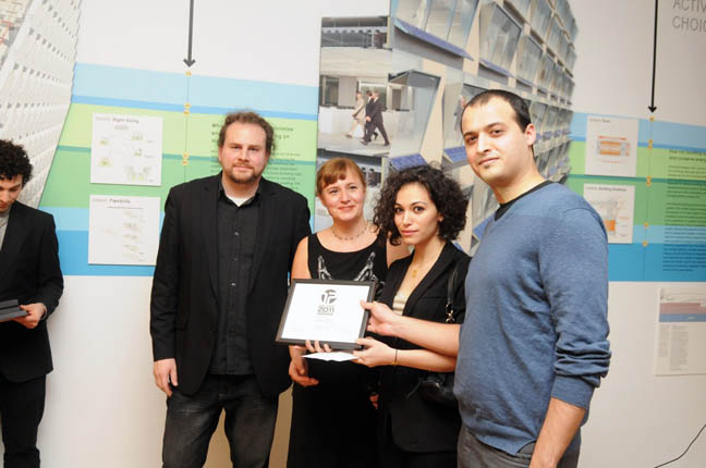 The Winners of the Competition Accepting the Award
