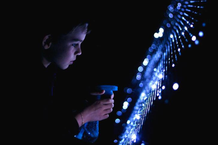 A Child Creating Glowing LED Aqua Art