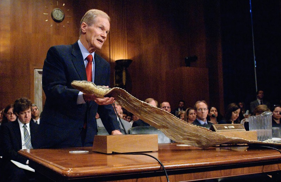 A Senator Showing off the Snake Skin of an Invasive Species